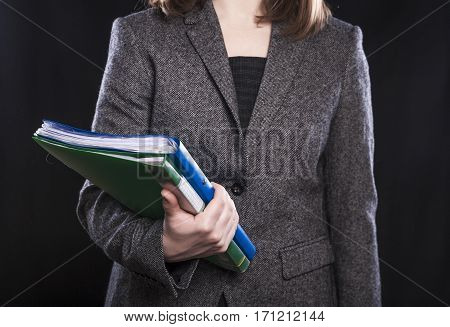 Woman manager with documents on black background