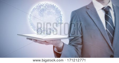 Midsection of businessman holding tablet computer against purple background 3d