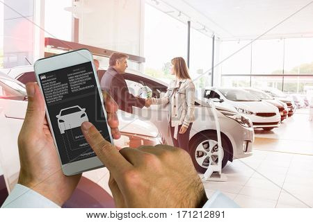 hand holding smartphone against salesman shaking a customer hand