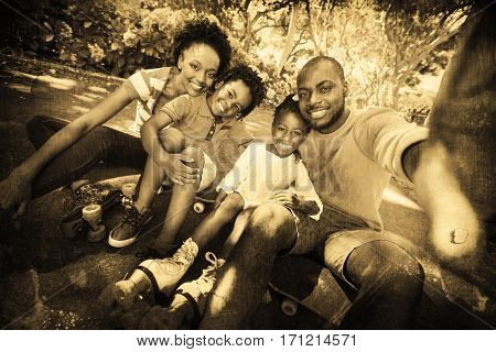 Grey background against portrait of happy family at park