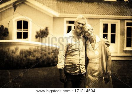 Grey background against senior couple with arms around standing in yard