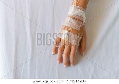 Saline Intravenous Drip On Children Hand