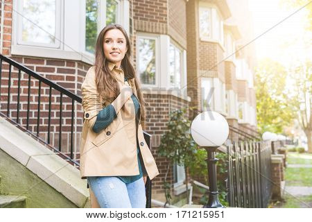Beautiful Woman Walking Out From Home In Toronto