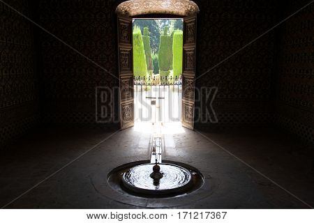 Old fountain in antique royal palace in Spain, Sevilla