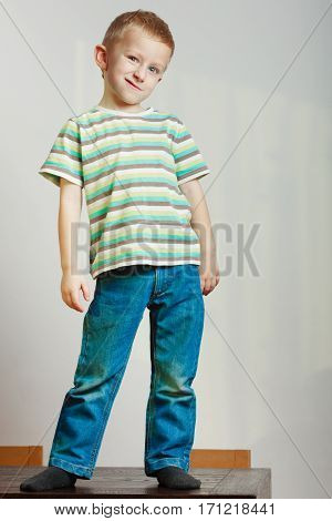 Face expressions children fashion concept. Portrait of happy kid boy looking straight to camera