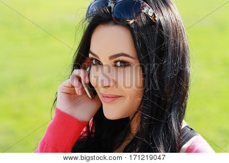 Close Up Of A Attractive Young Woman Speaking On Mobile Phone