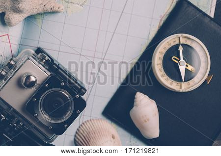 Old Compass And Action Camera. The Concept Of Direction Or Travel