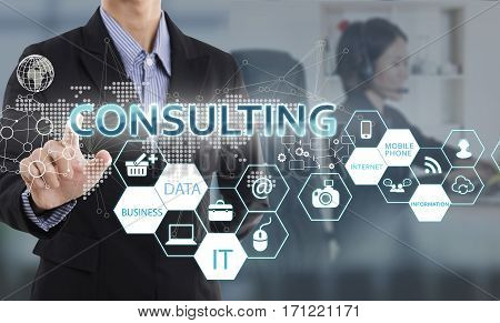 Businessman hand chooses Consulting wording on interface screen. internet technology service concept.