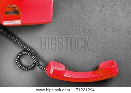 Landline Red Phone On A Gray Wall Background
