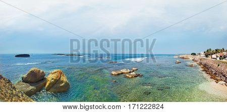 Ocean coast panorama with stones in Sri Lanka