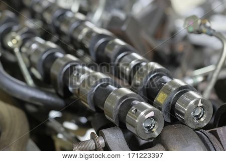 Camshaft  lies among details of the engine disassembled for repair