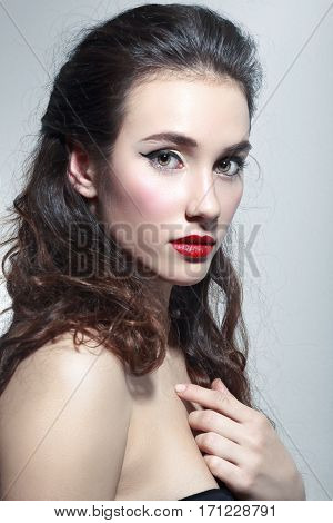 portrait of beautiful woman with red lipstick isiolated on neutral background in photostudio