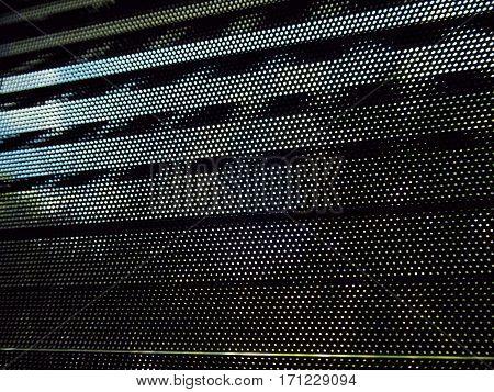 Many small eyelet on black metallic blinds