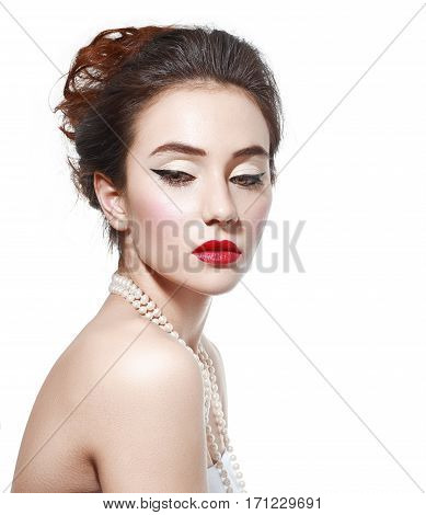 portrait of young beautiful woman with red lipstick wearing necklace isolated on white background in photostudio