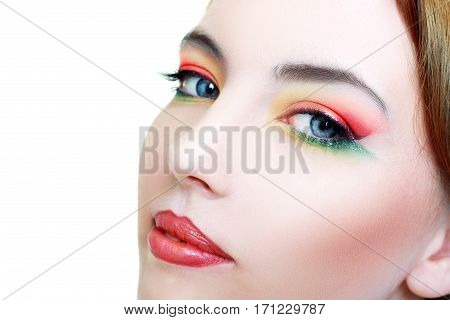 Close-up portrait of fashion woman model with beauty bright make-up juicy lips. Beautiful famale face with clean skin.