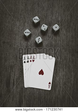 four aces playing cards and dice, game abstract background