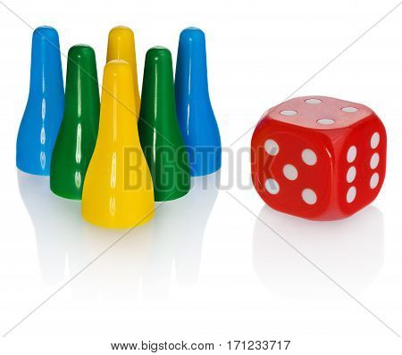 Colored pawns and red dice. Set pieces in the colors yellow green blue. Cube in red with white eyes. Set on a white background with slight reflection. On objects slight light reflections.