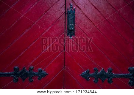 old red wooden door outside an American house in New England