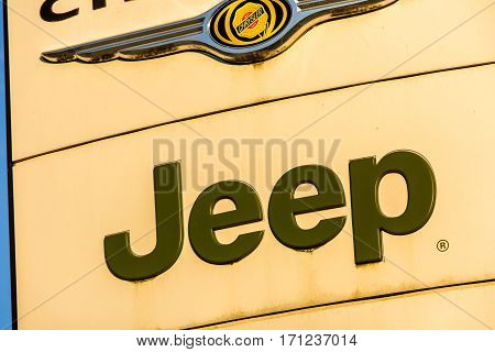 La Rochelle, France - August 30, 2016: Official Dealership Sign Of Jeep Against The Blue Sky. Jeep I