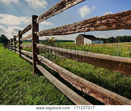 wood fence with a barn in the background in Gettysburg, Pennsylvania