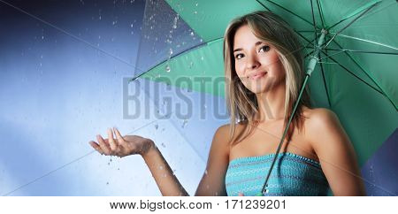 beauty girl with umbrella under rain