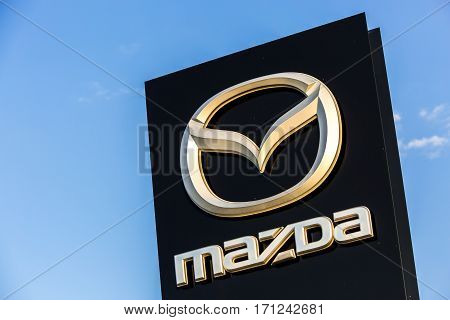 La Rochelle, France - August 30, 2016: Official Dealership Sign Of Mazda Against The Blue Sky. Mazda