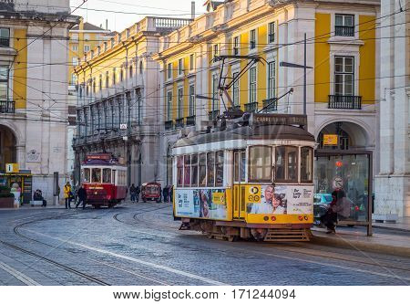 LISBON PORTUGAL - JANUARY 10 2017: Old trams on the Praca do Comercio (Commerce Square) in Lisbon Portugal.