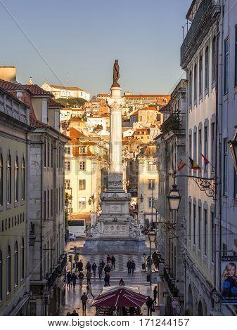 LISBON PORTUGAL - JANUARY 10 2017: Column of Pedro IV on Rossio Square (Pedro IV Square) in Lisbon Portugal seen from Calcada do Carmo street.