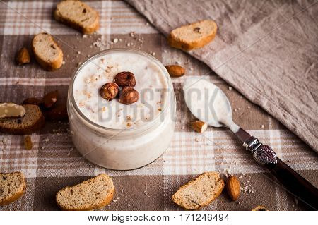 yogurt with rusks and nuts top view