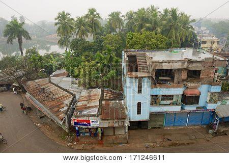 PUTHIA, BANGLADESH - FEBRUARY 21, 2014: View to the slum houses in downtown Puthia, Bangladesh.