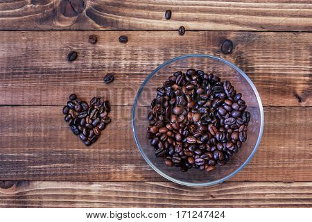 Coffee beans in heart shape and inside glass bowl