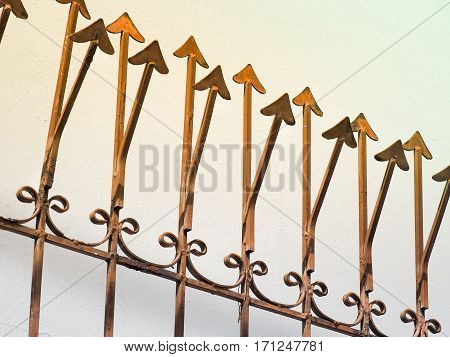 Rusty metal fence with sharp arrows, Used for textured and background, Image has a color effect applied.