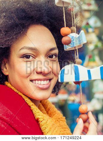 Beautiful Woman Buying Souvenirs In Gift Shop