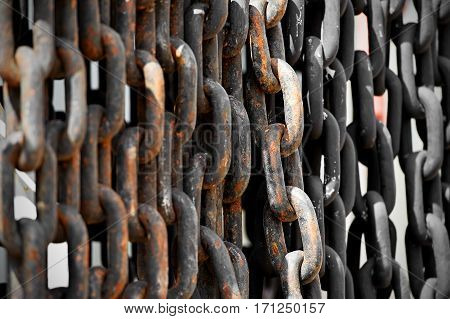 Detail shot with rusty links of an industrial chain