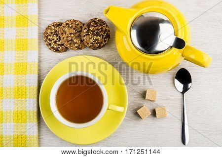 Tea In Cup, Teapot, Cookies, Teaspoon And Lump Sugar