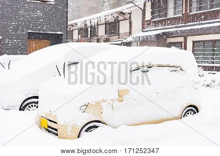 Close up of car cover by snow parking on the road Japan.