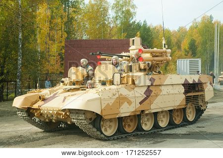 Nizhniy Tagil, Russia - September 25. 2013: Tank Support Fighting Vehicle Terminator move on the shooting demonstration range. RAE-2013 exhibition. Russia Arms Expo-2013