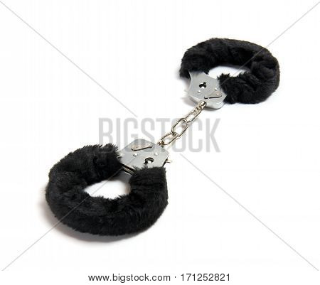 Black soft handcuffs isolated on white background