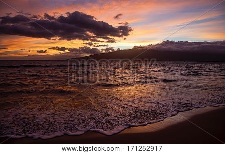 Sunset from Kihei Beach looking across the Pacific waters at the West Maui Mountains