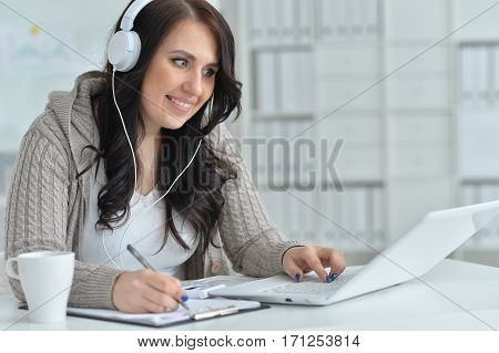 young beautiful brunette woman working at office using laptop