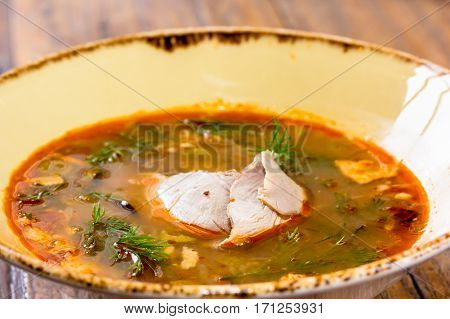 Thick Vegetable Soup With Meat Poured Into A Bowl. A Traditional Dish Of Russian Cuisine - Solyanka.