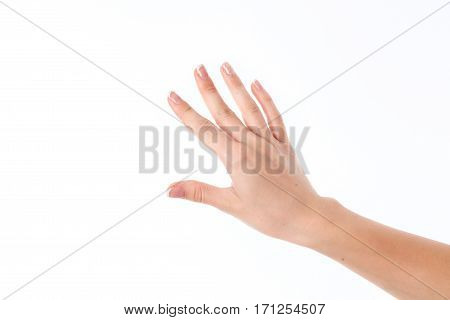 female hand stretched into the distance with your fingers is isolated on a white