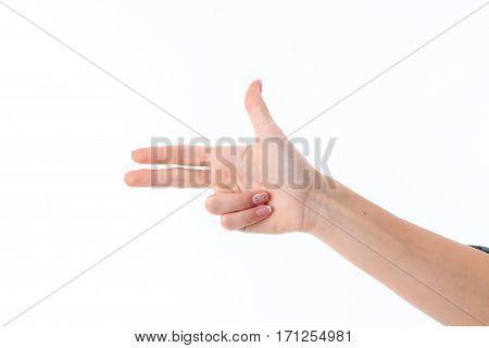 female hand showing with three fingers gesture isolated on white
