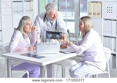 Portrait of doctors discussing something in cabinet