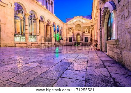 Colorful evening view at old city square Peristil in town Split, ancient roman architecture in front of Saint Domnius bell tower, croatian travel places.