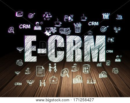 Finance concept: Glowing text E-CRM,  Hand Drawn Business Icons in grunge dark room with Wooden Floor, black background