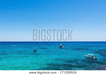 Photo of sea in protaras, cyprus island with boats and immaculate water.