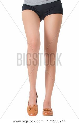 Woman beautiful long legs wearing leather shoes Isolated on white background.