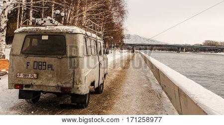 Kazakhstan, Ust-Kamenogorsk, 2 february, 2017: Utility car rides along the embankment
