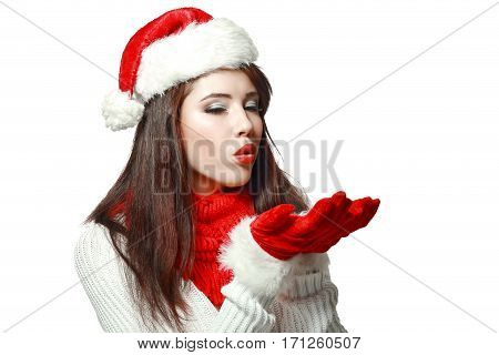 portrait of young woman in red gloves blowing in her palms isolated on white in photostudio
